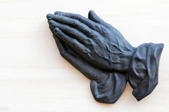 The praying hands of an old woman. Made of metal Royalty Free Stock Image