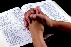 Praying Hands on Open Bible Royalty Free Stock Photos