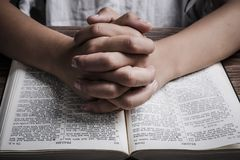 Praying Hands With Holy Bible royalty free stock images