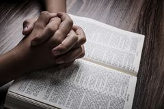 Praying Hands With Holy Bible stock image