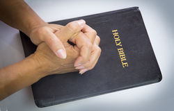 Praying hands over holy bible Royalty Free Stock Image