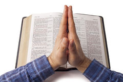 Praying hands over open bible Royalty Free Stock Images