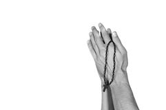 Praying hands with rosary. Black and white. Isolated on white background Stock Photography