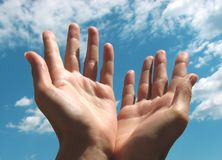 Praying hands by the sky Royalty Free Stock Image