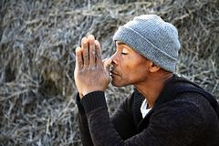 Praying with hands together Royalty Free Stock Image
