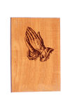 Praying hands on wood Royalty Free Stock Photo