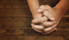 Praying Hands. On a wooden table royalty free stock images