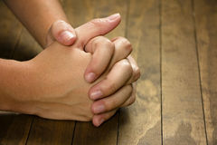 Praying Hands. On a wooden table stock photos