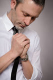 Praying handsome man. Portrait of a handsome praying business man Royalty Free Stock Photos