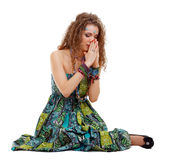 Praying hippie girl sitting on the ground Royalty Free Stock Images