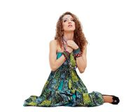 Praying hippie girl sitting on the ground Stock Photography