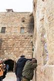 Praying at the holy walls Stock Photography