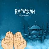 Praying human hands for holy month Ramadan Kareem celebration. Stock Photos