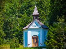 Praying inn the chapel for a safe hike to the muntain top inSlovenia royalty free stock images