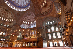 Praying inside the Blue Mosque Royalty Free Stock Photos