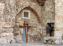 Praying in Jerusalem. A man is holding his head against the old Etihopian church and praying (Jerusalem, Israel royalty free stock photos