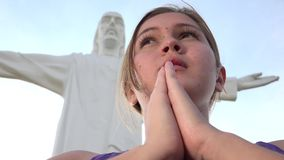 Praying At Jesus Statue. Stock video in 4k or HD resolution stock footage