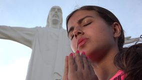 Praying At Jesus Statue. Stock video in 4k or HD resolution stock video footage