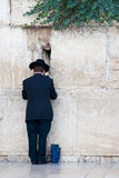 Praying jew in Jerusalem. Jew praying at the Western Wall in Jerusalem, Israel Royalty Free Stock Images