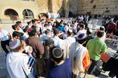 Praying Jews. Jews pray at the Kotel in Jerusalem, Israel. The kotel is one of the holiest sites in Judaism attracting thousands of worshipers daily Royalty Free Stock Photos