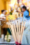 Praying joss stick burns in the compound of a budd Royalty Free Stock Photography