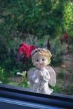 Angel prays at the window. Religious symbol. royalty free stock photo