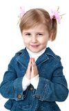 Praying little girl Stock Images