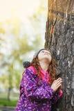 Praying little girl looking up. stock image