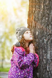 Praying little girl looking up. Happy childhood and world peace Royalty Free Stock Photography