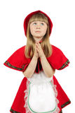 Praying little girl in red hood costume on the white background Stock Photo