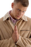 Praying male looking at camera Stock Photography