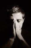 Praying man. Praying man on sepia portrait Royalty Free Stock Image