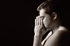 Praying man. Praying man in sepia tone Royalty Free Stock Image