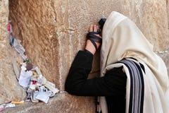Praying man Stock Images