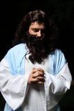 Praying man. Biblical or middle eastern man head bowed and praying stock photo