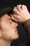 Praying Man. Young man praying, on a black background Stock Photography
