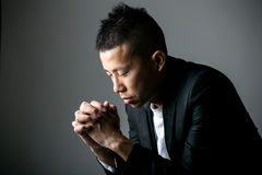 Praying man. With black background Stock Photography