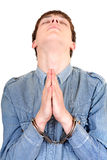 Praying Man in Handcuffs Royalty Free Stock Photos
