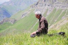 Praying man kneeling Stock Images
