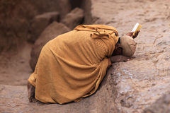 Praying man in Lalibela, Ethiopia. Orthodox ethiopian priest - near the the saint George church in Ethiopia, Africa Royalty Free Stock Images