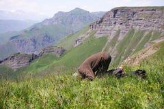 Praying man making low bow Royalty Free Stock Image