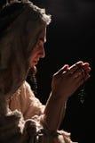 Praying man. In monks clothing Royalty Free Stock Images