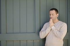 Praying man outside. Stock Photos