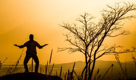 Praying man silhouette Royalty Free Stock Photography