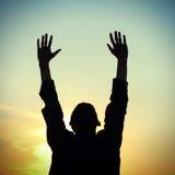 Praying Man Silhouette Stock Image
