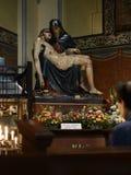 Praying man. The statue of Pieta. stock images