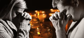 Praying man and woman. stock images