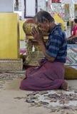 Praying men at Kyaukhtatgyi Buddha Stock Images