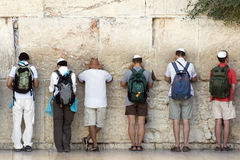 Praying men at Western wall in Jerusalem, Israel Royalty Free Stock Image