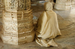 Praying monk insaid the Jain temple in India Stock Image